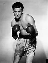 Actor William Holden in boxing gear. While the shorts might look great, it is not recommended to wear vintage sportswear and underwear
